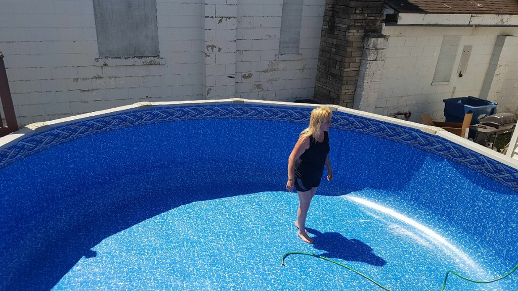 You can see our beloved owner, Christie, hard at work installing a brand new 18' Round Above Ground Liner. Because these pools come in standard sizes, we use liner replacement kits (typically on-hand or from our local distributor) to replace your liner. Just select your pattern from our list of material selections and you're on your way to brand new pool for Summer!