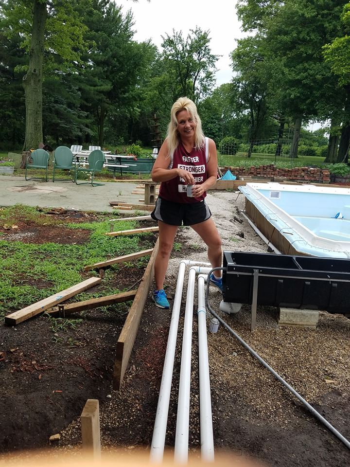 We are hard at work this week installing a new Fiberglass Swimming Pool. Kristie Cheatum is seen here managing the install of the plumbing lines & Automated Pool Cover. Kristie is a hands on kind of girl and a professional installer to say the least!