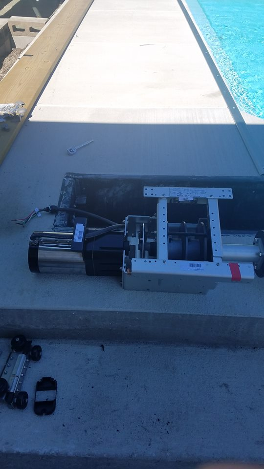 This picture shows our pool cover set into our polymer box, with the motor and braces on the left. The beauty of these pools covers is that they are easy to access to service and maintain. This provides a great way for us to work with these systems and keep them operating smoothly!