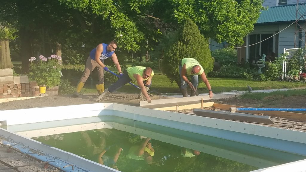 "Concrete is tough work! These gentlemen had to carefully operate around the smoothed wet cement and are essentially working backyards. You always want to ensure you do not walk on the ""smoothed"" side of your wet cement. They took create care to touch up our concrete deck and left us with a great finished product!"