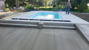 We have made some impressive headway and completed the fiberglass pool installation (if you've been following our blog). The final stages of this project were pouring our concrete pool deck, cleanup & pool startup. Now this home owner has a beautiful fiberglass swimming pool to enjoy for many warm days outside!