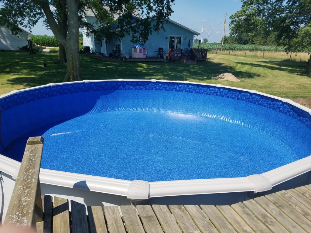 We are hard at work this week completing the installation on 4 new above ground swimming pools! We have been truly blessed this year with some tremendous growth and we are very grateful for our loyal customers and new business! Let's take a look at this new 27' Round Nova Above Ground Pool Installation!