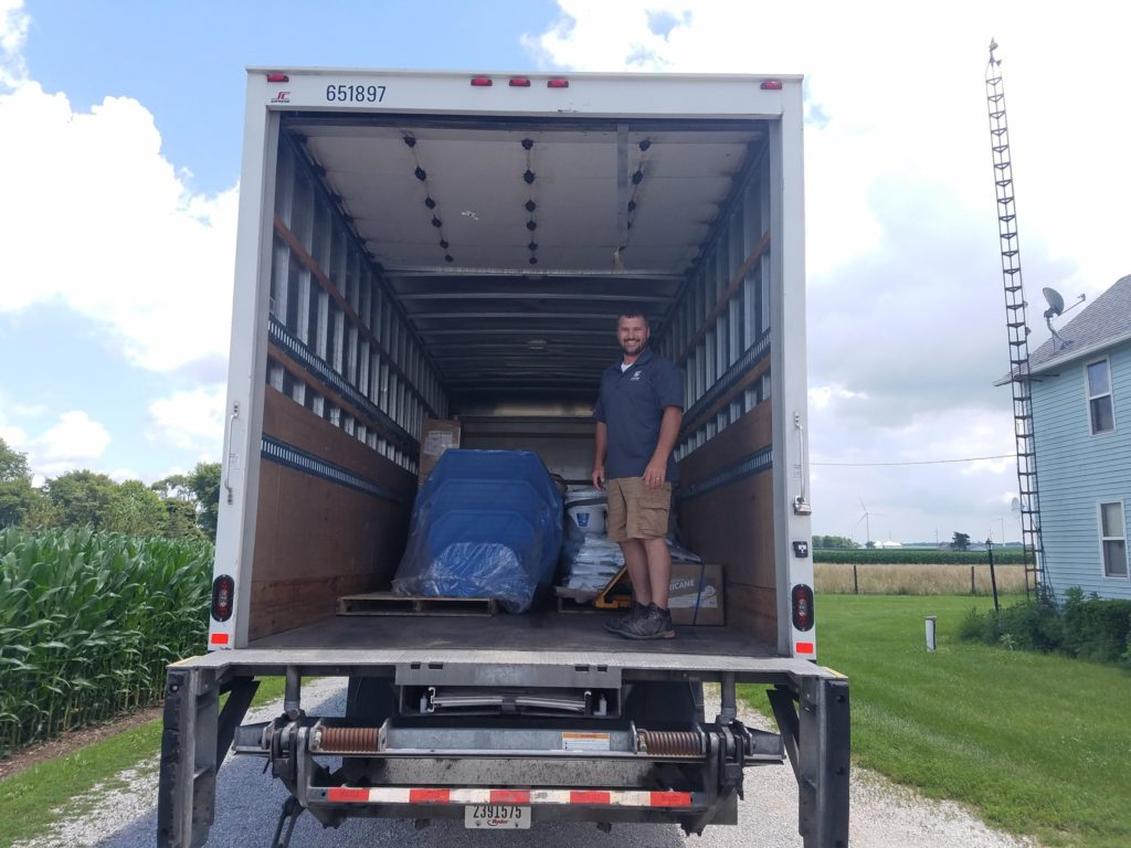We are lucky to have such a supportive network of suppliers and vendors. This image shows our delivery from our local supplier. They often meet us in the field and at job sites to provide us with on-time deliveries. Here you can see their driver delivering a new Above Ground Pool package they day of our installation.
